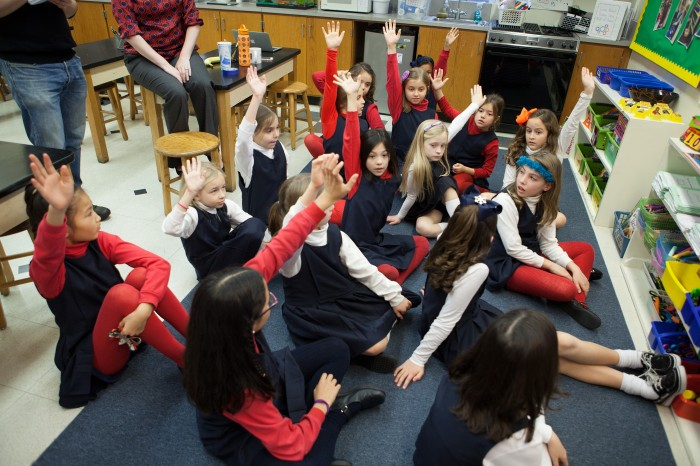 marymount-school-girls-raising-hands